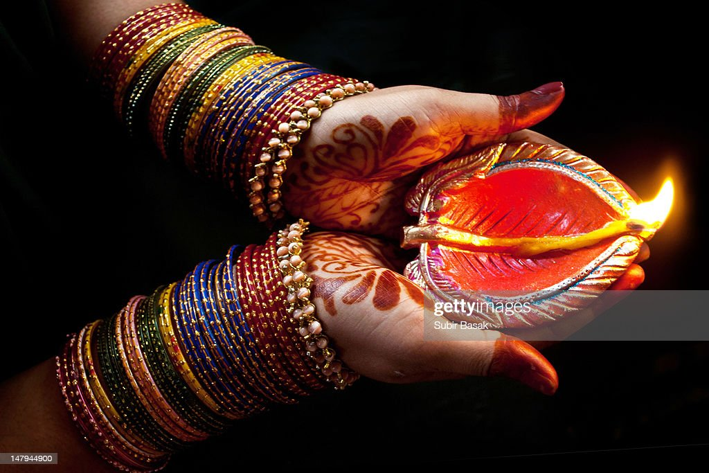 Woman with lit earthen lamp at Diwali festival : Stock Photo