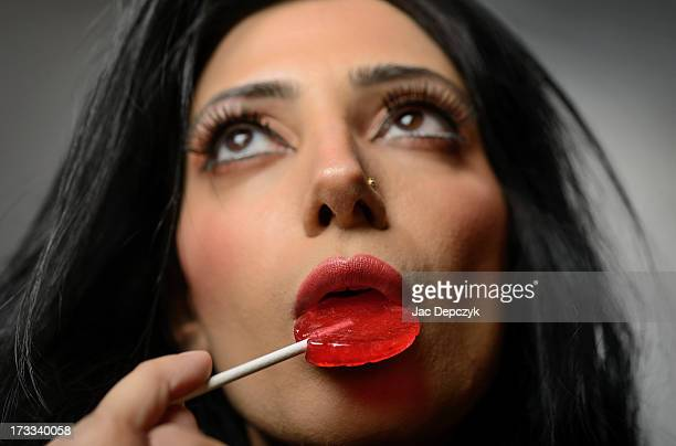 woman with lollipop looking upwards - depczyk stock pictures, royalty-free photos & images