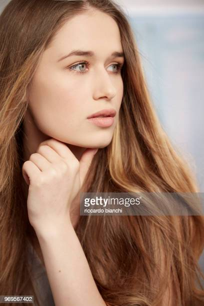 woman with long beautiful hair and natural look looking right