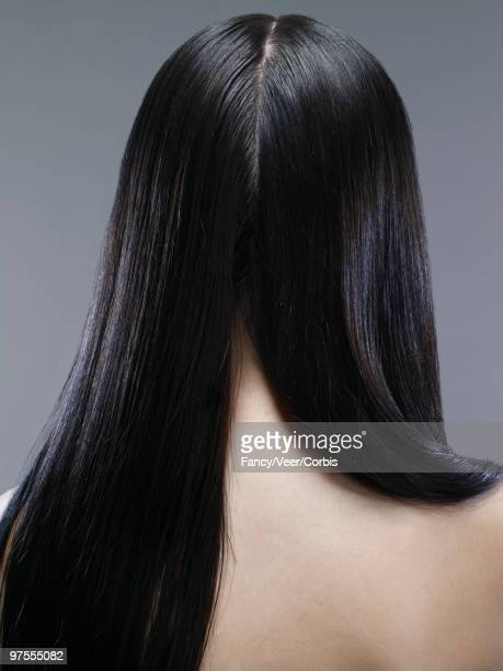 Woman with long black hair parted