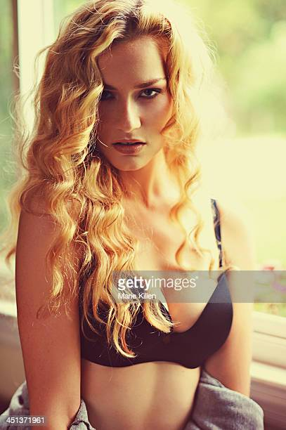 Woman with long blonde hair and black bra