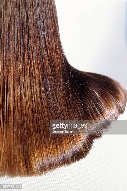 woman with long brown hair falling across shoulder,back view,close-up - straight hair stock pictures, royalty-free photos & images