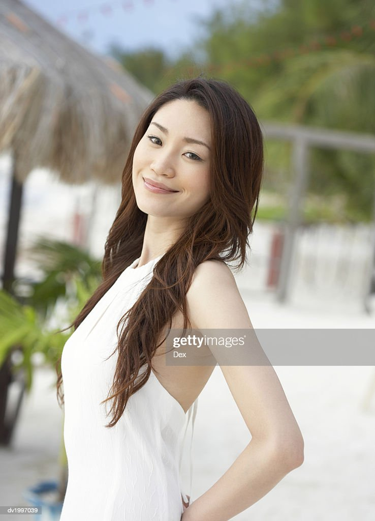 Woman With Long Brown Hair Wearing a White Dress : Stock Photo