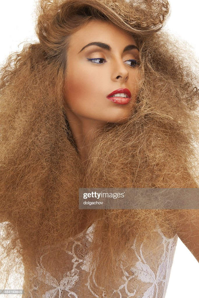 woman with long curly hair : Stock Photo