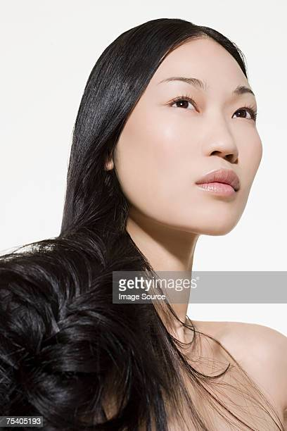 woman with long dark hair - asian model stock photos and pictures