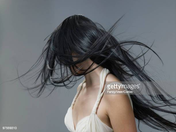 Woman with long flowing black hair
