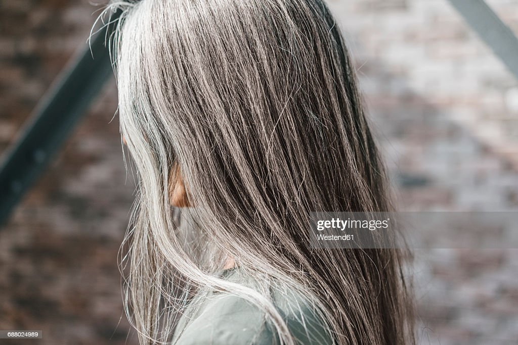 Woman with long grey hair : Stock Photo
