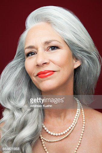 Woman With Long Grey Hair Wearing Pearls Stock Photo