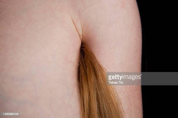 a woman with long hair coming from her armpit - armpit hair woman stock pictures, royalty-free photos & images