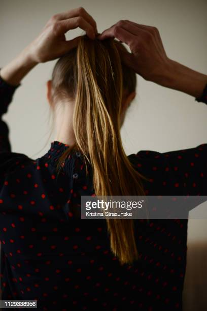 woman with long hair in a high ponytail - ponytail stock pictures, royalty-free photos & images