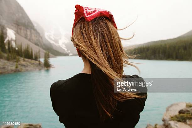 woman with long hair overlooking moraine lake - banff stock photos and pictures