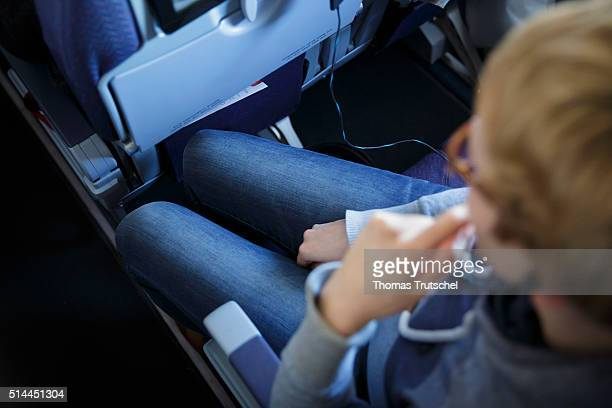 New York United States of America February 23 A woman with long legs sitting on her seat in economy class in an aircraft on February 23 2016 in...