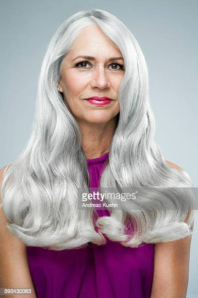 Woman with long, shiny, gray hair, portrait.