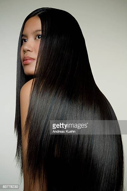 woman with long shiny hair, profile. - steil haar stockfoto's en -beelden