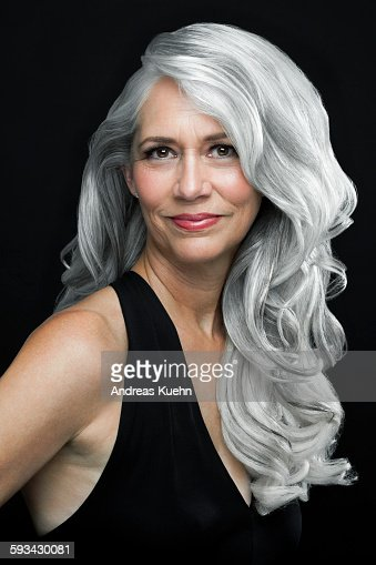 Woman With Long Wavy Gray Hair Portrait Stock Photo