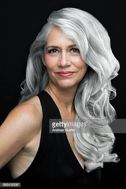 Woman with long, wavy gray hair, portrait.