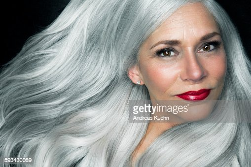 Woman With Long White Hair And Red Lipstick High Res Stock
