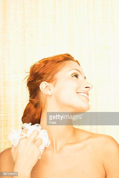woman with loofah - loofah stock photos and pictures