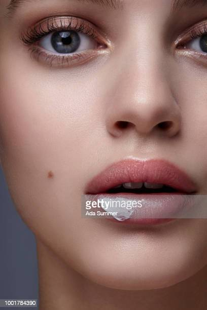 Woman with  lotion on her lip