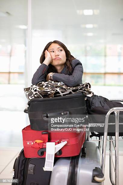 Woman with luggage waiting in airport
