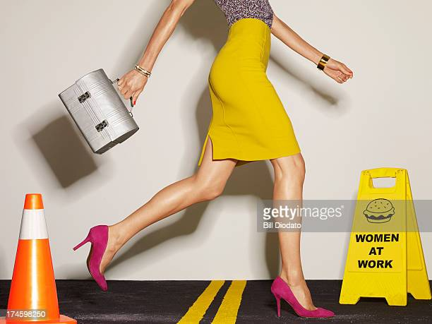 woman with lunch box walking in street - high heels stock pictures, royalty-free photos & images