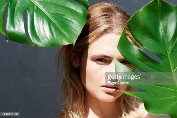 Woman with lush green foliage
