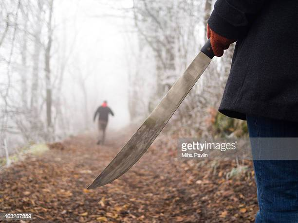 Woman with machete chasing man