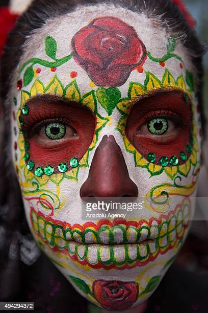 A woman with make up poses during Procession of the Catrinas in Mexico City Mexico on October 25 2015 The Catrina is a figure of a skeleton wearing...