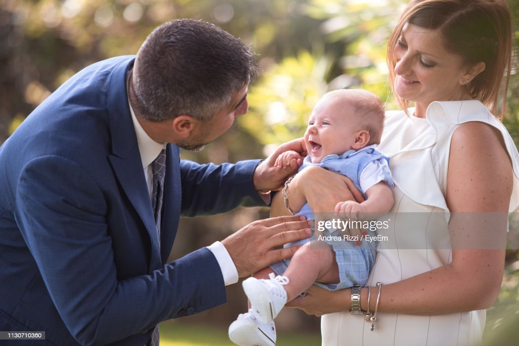 Woman With Man Holding Baby Boy : Foto stock