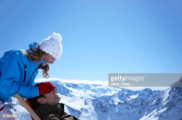Woman with man sitting in deck chair