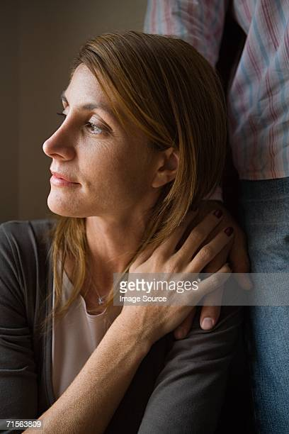 woman with man's hand on shoulder - hand on shoulder stock photos and pictures