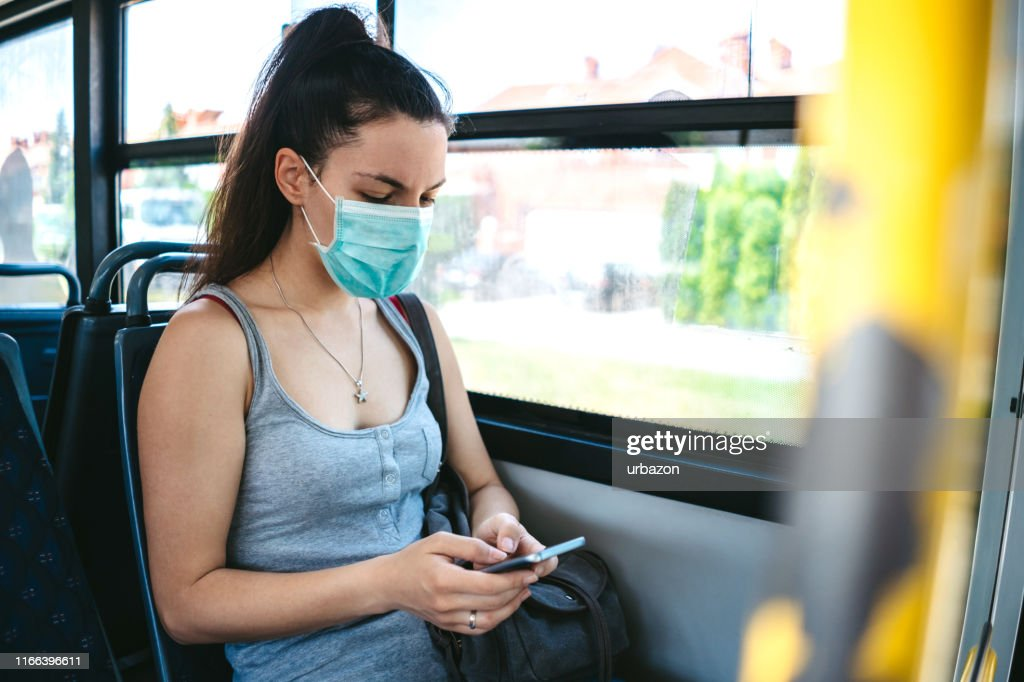 Woman with mask in bus : Stock Photo