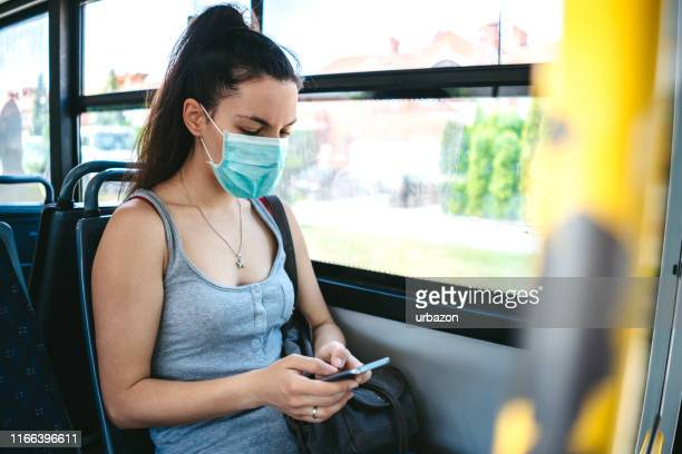 woman with mask in bus - virus stock pictures, royalty-free photos & images