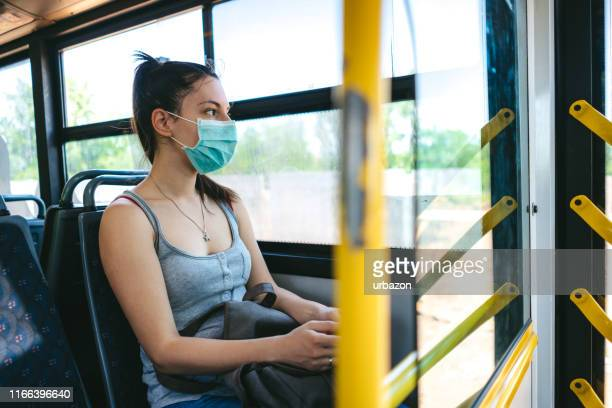 woman with mask in bus - autocarro imagens e fotografias de stock