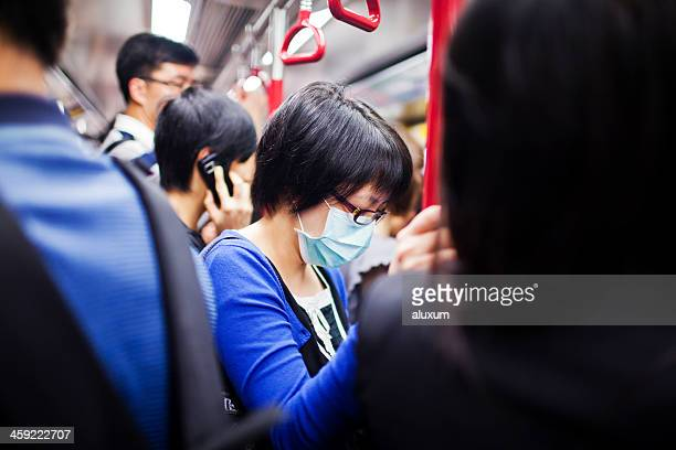 woman with mask in subway train - epidemi bildbanksfoton och bilder