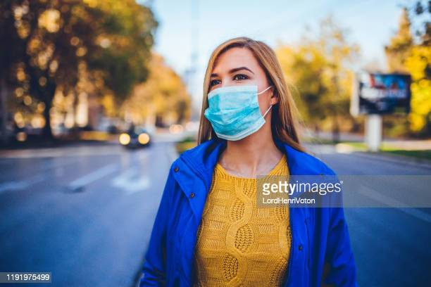 woman with mask - surgical mask stock pictures, royalty-free photos & images