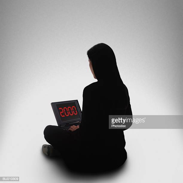 Woman with Millennium Laptop