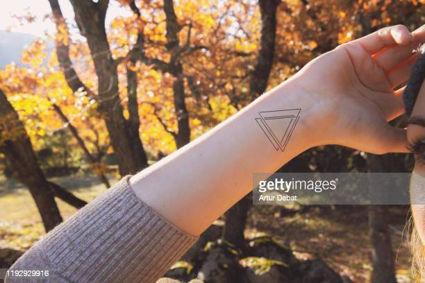 woman with minimal tattoo on wrist. - wrist stock pictures, royalty-free photos & images