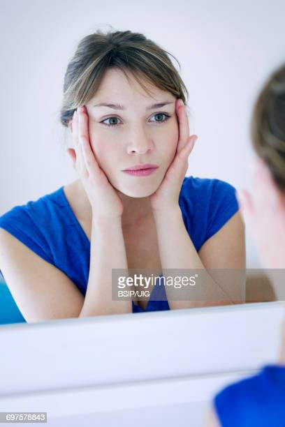 Woman with mirror