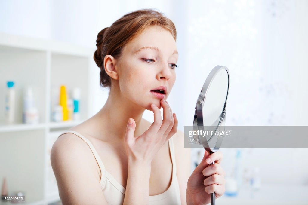 Woman with mirror : Stock Photo