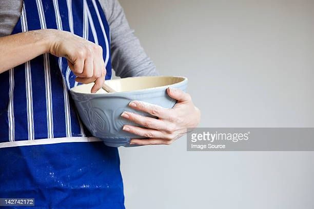 Woman with mixing bowl