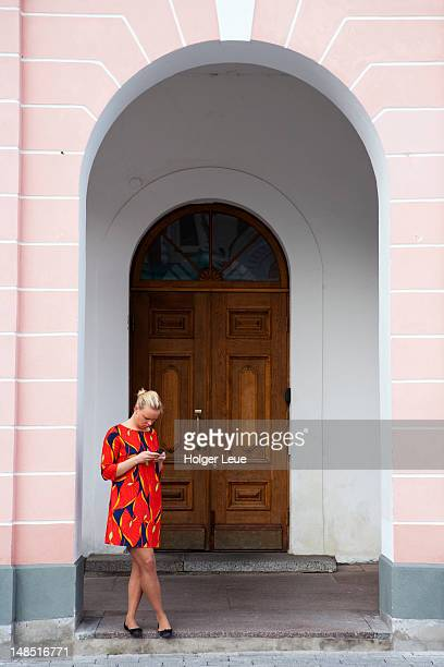 woman with mobile phone outside toompea castle. - harjumaa stock pictures, royalty-free photos & images