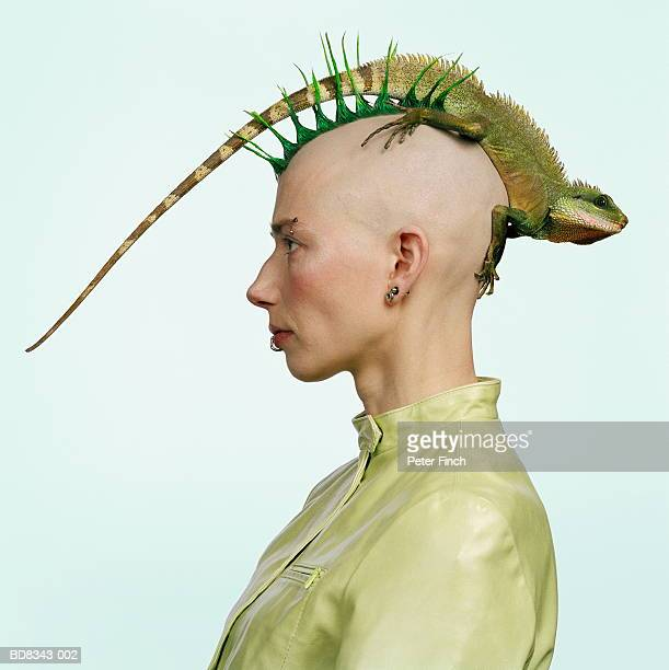 woman with mohican hairstyle, water dragon on head, profile - animals and people stock pictures, royalty-free photos & images