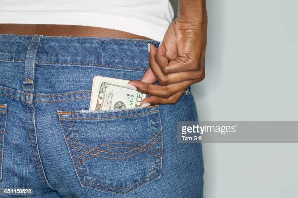 Woman with Money in Her Back Pocket