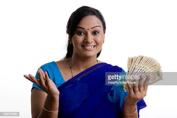woman with money - number 500 stock pictures, royalty-free photos & images