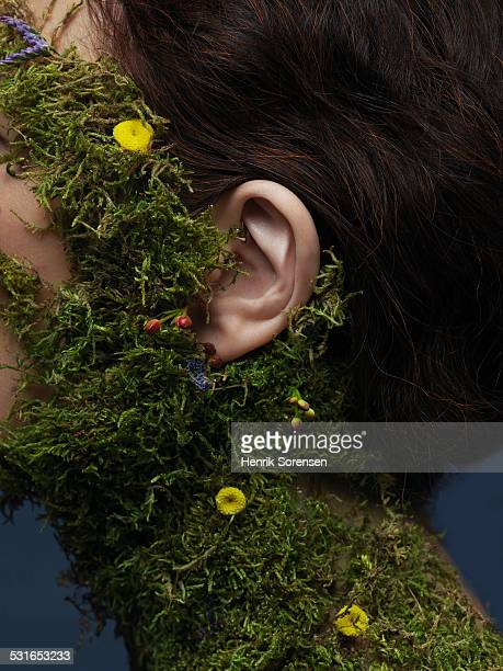 woman with moss on her neck