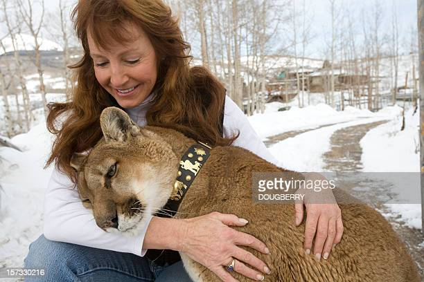 woman with mountain lion - puma stock photos and pictures