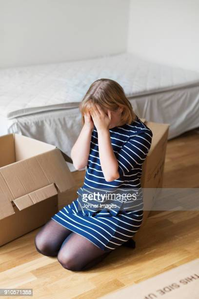 woman with moving boxes - endopack stock pictures, royalty-free photos & images
