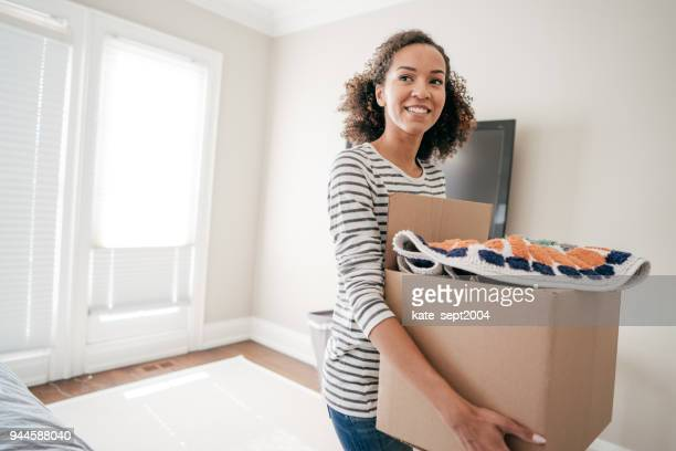 woman with moving boxes - arranging stock pictures, royalty-free photos & images