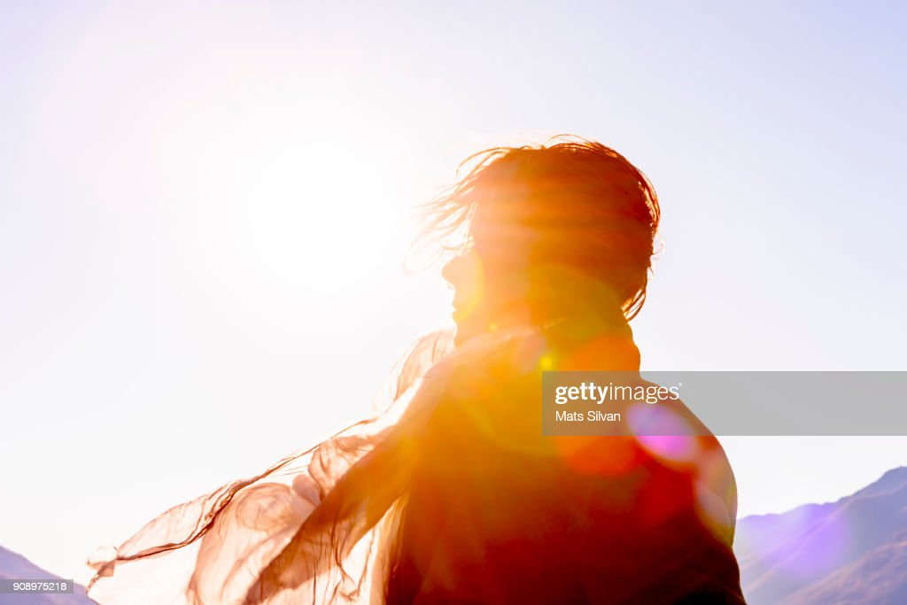 Woman with Moving Hair and Scarf in Sunlight in a Windy Day : Stock-Foto